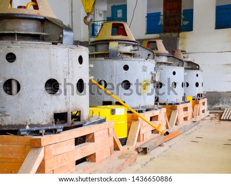 Engines of water pumps at a water pumping station. Pumping irrigation system of rice fields. Room control and maintenance of pump electric motors.