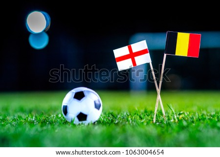 England - Belgium, Group G, Thursday, 28. June, Football, National Flags on green grass, white football ball on ground. #1063004654