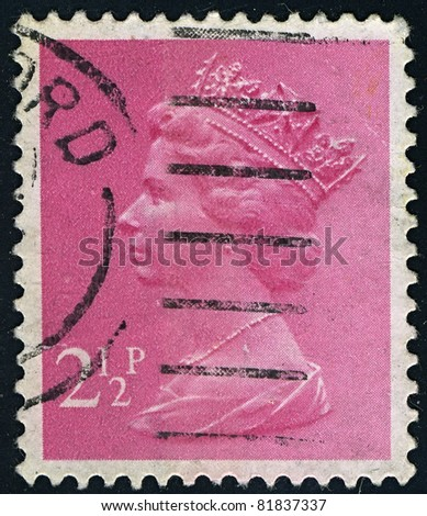 ENGLAND-CIRCA 1971:A stamp printed in ENGLAND shows image of Elizabeth II (Elizabeth Alexandra Mary, born April 21, 1926) is the constitutional monarch of United Kingdom in pink, circa 1971.
