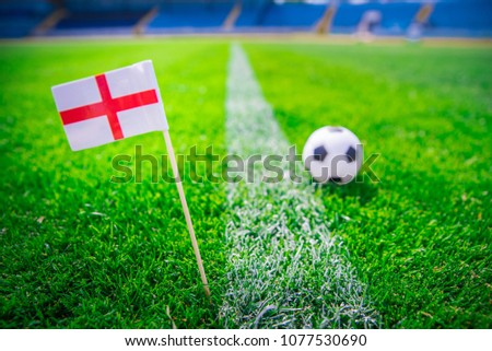 England national Flag and football ball on green grass. Fans, support photo, edit space.  #1077530690