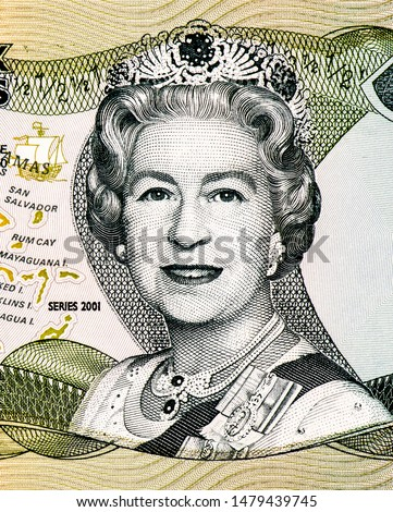 England Queen Elizabeth II Portrait from Bahamas 1/2 Dollar 2001 Banknotes. An Old paper banknote, vintage retro. Famous ancient Banknotes. Collection.