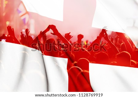 england supporters - double exposure of England flag and football fans celebrating victory #1128769919