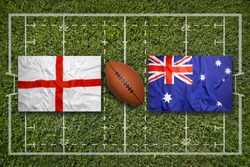England vs. Australia flags on green rugby field