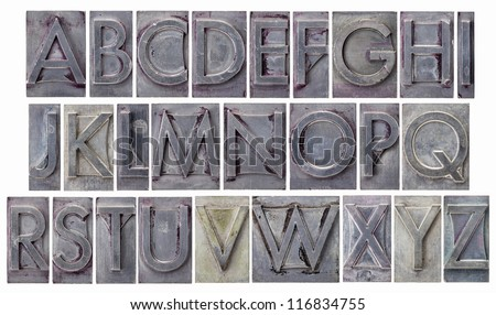 English alphabet - a collage of 26 isolated letters in grunge letterpress metal type, scratched and stained by ink