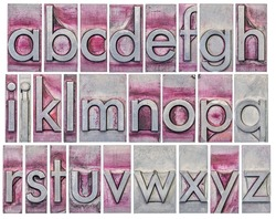 English alphabet - a collage of 26 isolated lowercase letters in grunge letterpress metal type, scratched and stained by purple ink