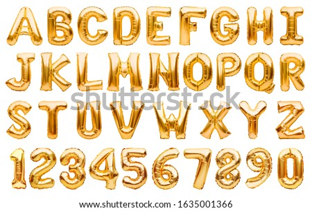 English alphabet and numbers made of golden inflatable helium balloons isolated on white. Gold foil balloon font, full alphabet set of upper case letters and numbers