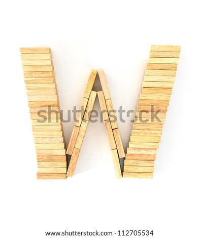english alphabet  letters from wooden domino on white background, letter W