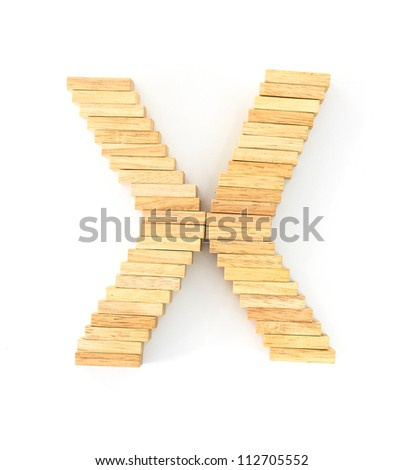 english alphabet  letters from wooden domino on white background, letter X