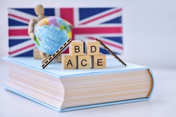 English aplhablets and the lean ladders on the book with world globe and England flag symbol background
