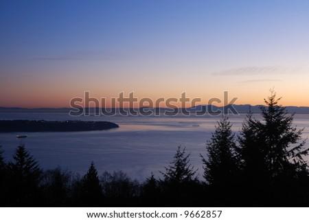 english bay sunset viewed from cypress mountain - stock photo