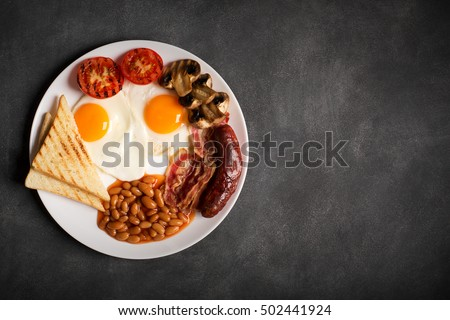 English breakfast on a black chalkboard, copy space for text #502441924