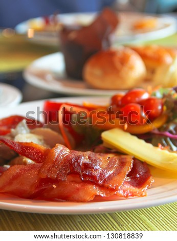 English Breakfast with grilled tomato , bacon ,mushrooms,cheese  and salad on Table