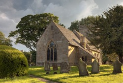 English church with cloudy sunset, Gloucestershire