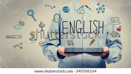 English concept with young man holding a tablet computer