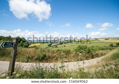 English countryside, with public footpath sign, wide angle image.