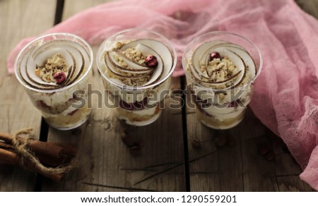 English dessert trifle. Dessert in a cup. three desserts on the wooden table #1290559201