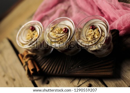 English dessert trifle. Dessert in a cup. three desserts on the wooden table #1290559207