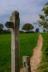 English footpath sign on sunny day