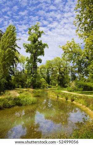 English garden and river in Marie-Antoinette\'s estate. Versailles Chateau. France