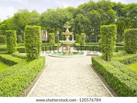 English garden in summer, Lush Green Topiary