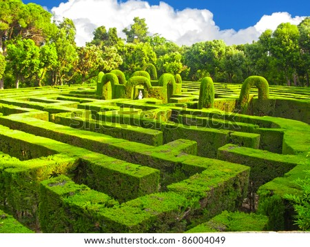 English green labyrinth with a cloudy sky