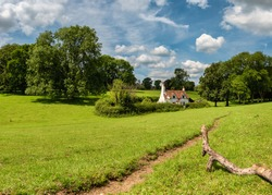English landscape with old cottage and a hiking path in the Chiltern Hills, UK