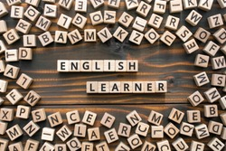 English learner - phrase from wooden blocks with letters, student  english learner concept, random letters around, wooden background