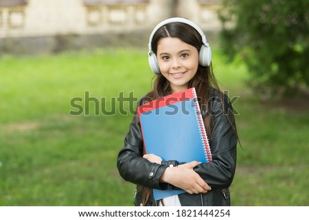 English learning courses. Happy girl learn English. Little child hold English books. Listening comprehension skills. English literature and grammar. Private lesson. Foreign language school.