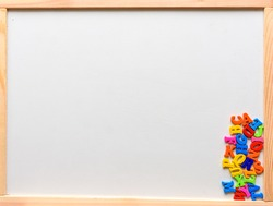 English letters are scattered on the board for teaching children to write and read.