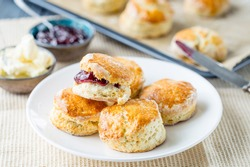 English Pastries, Scones with Raspberry Jam on Rustic Table, Horizontal View