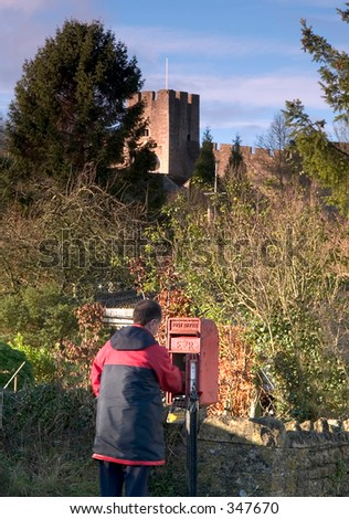 English postman collecting the mail - stock photo