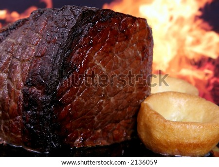 English roast meat by fire with flames, traditionally eaten with yorkshire pudding