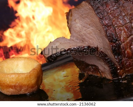 English roast meat by fire with flames, traditionally eaten with yorkshire pudding, macro