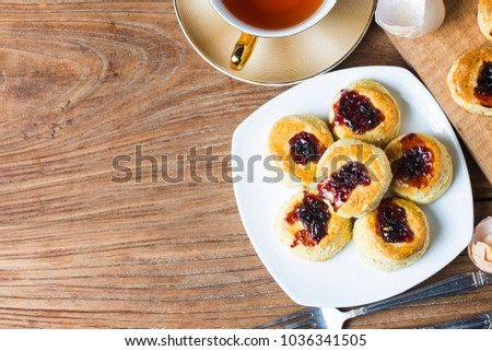 English scones with cream and strawberry jam