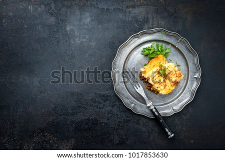 English shepherds pie as top-view on a pewter plate with copy space left  #1017853630