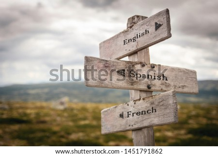 English, spanish and french signpost outdoors in nature. Learn, teach, languages, education, international concept. #1451791862