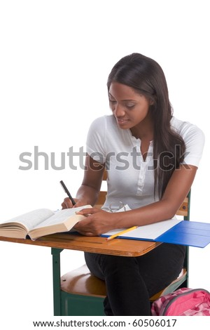 English spelling-bee contest education series - ethnic black female high school student studying dictionary preparing for test, exam or spelling bee contest - stock photo