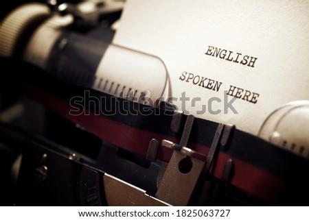 English spoken here phrase written with a typewriter. Stock photo ©