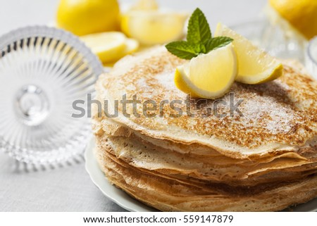 Shutterstock English-style pancakes with lemon and sugar, traditional for Shrove Tuesday