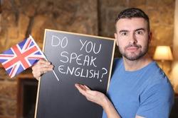 English teacher holding British flag