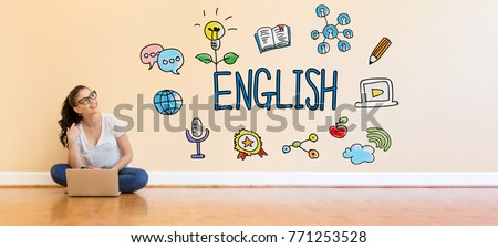 English text with young woman using a laptop computer on floor Foto stock ©