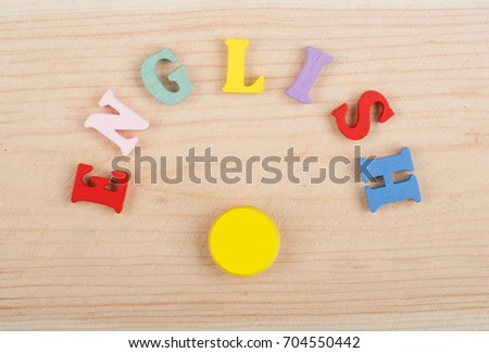 English word on wooden background composed from colorful abc alphabet block wooden letters, copy space for ad text. Learning english concept #704550442