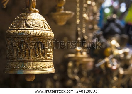 Engraved Bronze Bell These are used as decoration items at the entrance of several places - like homes, theatres, entertainment centers, museums etc with engravings of folklore.  - Shutterstock ID 248128003