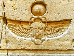 Engraved figure of the Egyptian god on the wall inside the Edfu temple in Egypt