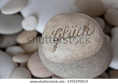 Engraved Pebble With German Word For Happiness