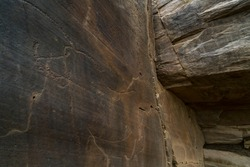 Engravings of paleolithic rock art at open-air in Piscos valley within Coa Valley in Portugal, Europe, Worl Heritage Site by the Unesco