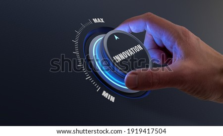 Enhancing innovation and technology development concept with a person choosing higher innovative products by turning a knob or dial by hand. Business strategy about engineering and research.
