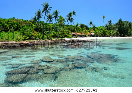 Enjoin a good summer time on the beach with clear water and blue sky at Bang Bao Beach on Koh Kood island in Gulf of Thailand