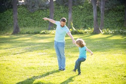 Enjoy every moment. Happy family enjoy summer outdoors. Playful father and son. Family fun