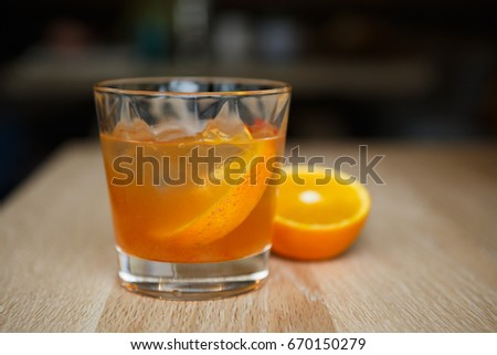 Enjoy refreshing tequila sunrise long drink in bar.Juicy cocktails for party.Crystal glass with orange juice booze.Hot drink for adults.Delicious refreshing orange cocktail with rum.Alcoholic drinks